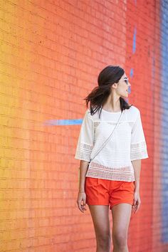 The epitome of summer in the city. Bright, colorful shorts pop with a feminine geometric lace blouse. Add heeled huarache sandals, bright lips and retro shades for cool, polished street-style.   Banana Republic