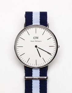 Classic modern watch from Daniel Wellington, with sleek minimal design. Features silver watch case with adjustable Nato strap. Clockwork: Quartz Japan citizen 1L22 movement. Size (diameter): 40 mm Height of casing: 6 mm Water resistant