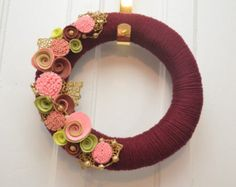 This 10 wreath is covered in twine and JAM PACKED with colour and glitter accents.  Felt colours are light pink, dark purple, strawberry, white, light purple, and strawberry parfait. It includes pearl beads, white, bright red and lavender glitter accents.*  A shabby chic wreath for Valentines day. Perfect for your modern or rustic home, cottage, or office. A statement piece thats sure to get a lot of attention!  This wreath is available in a variety of colours and can be made in 2 sizes. 10…