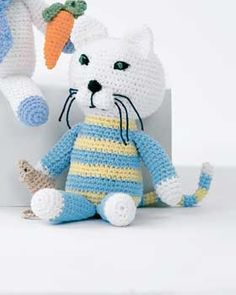 Sweet kitty and mouse for you to crochet. Shown in Lily Sugar 'n Cream.