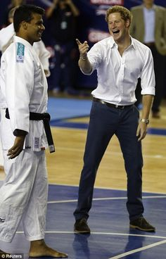 Prince Harry teaches Correa a few things about basketball at the Minas Tenis Clube. June 24, 2014
