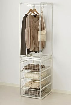 Hang freshly ironed shirts on the rail and stack folded items in the four drawers ready to be taken back to your wardrobe - an ideal ironing companion. Find more storage ideas at housebeautiful.co.uk