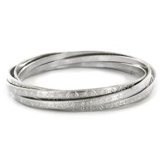 Stainless Steel Engraved Design Bangle Bracelet Set  @Overstock - These lovely interlocking bangle bracelets are beautifully engraved and crafted from a highly polished sterling silver. They fit most wrists and secure with lobster claw clasps.http://www.overstock.com/Jewelry-Watches/Stainless-Steel-Engraved-Design-Bangle-Bracelet-Set/7264005/product.html?CID=214117 $14.99