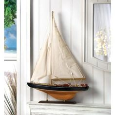 Sail away on dreams of adventure; let this magical ship be your guide! Stunning wood and canvas model is so amazingly lifelike, you'll practically hear the waves breaking over the bow. The perfect gift for any true sailor at heart!​ Some assembly required