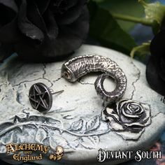 Alchemy Gothic E356 Magic Ram's Horn Faux Stretcher (single)  A pewter fake stretcher stud piercing, in the form of an antiqued, gnarled and twisted ram's horn. The end cap, with a standard surgical steel post, is in the form of a pentagram disc.