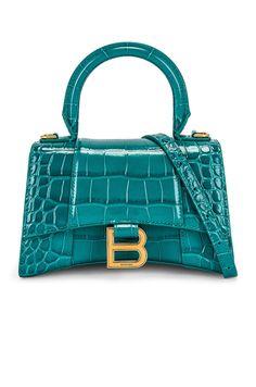 Wool Overcoat, Signature Logo, Women Brands, Online Bags, Creative Director, Hermes Kelly, Antique Gold, Balenciaga, Gym Bag