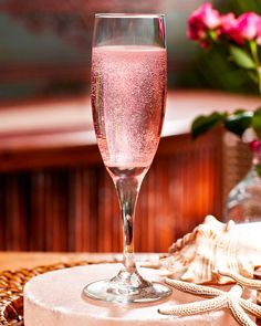 Emmy DE * Tommy Bahama Rose Petal Sparkler :: 3/4 part rose syrup   4.5 parts sparkling wine   Pour ingredients into a champagne glass and top with edible rose petals.
