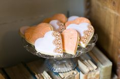 Heartshaped cookies with peach icing and lace detailing | wedding cookies | wedding desert inspiration. For more inspiration visit www.weddingsite.co.uk