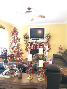 Christmas tree in burgundy, gold and white. Tree topper in gold and burgundy by Julie Siomacco of SouthernCharmWreaths #christmas #decorating #mantle