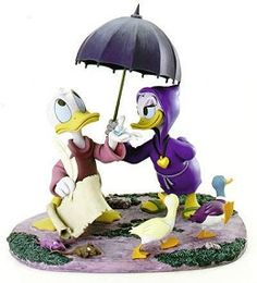 WDCC Disney Classics Fantasia 2000 Donald And Daisy Looks Like Rain #WDCCDisneyClassics #Art. Daisy's Umbrella Handle: Bronze. Locket: Metal. Raindrop (falling in Donald's hand): Clear resin. Small Ducks: One has a pewter leg. The umbrella top is a separate piece. Numbered Limited Edition (NLE) of 2,000 in honor of the films release year.Music: Pomp and Circumstance - Elgar.