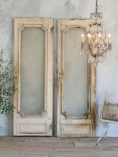 enchanting chandelier + double distressed doors