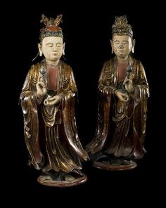 A pair of gilt, black lacquered and polychrome wood worshippers, Vietnam, 19th Ct.Photo Nagel