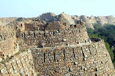 Tughlaqabad Fort Constructed in the year 1320, it is a is a very evocative place, a vast stonescape hugging a rocky spread.