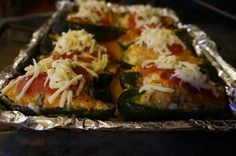 stuffed poblano peppers - stuffing is made with ground chicken, cilantro, jalapenos, onions, garlic, mexican rice, and other yummy stuff