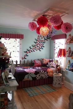 Beautiful bedroom for a teen. Decorated with butterflies of various colors and paper flower lanterns.