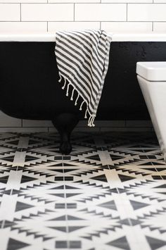 These patterned monochrome tiles are gorgeous - perfect for stylish bathrooms.