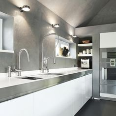 Beautiful modern kitchen with white cabinets stainless steel faucets and countertop Exquisite Kitchen Faucets Merge Italian Design With Elegant Aesthetics