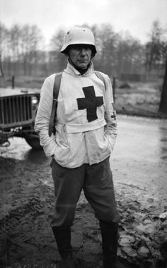 Portrait of a German medical orderly captured by British troops. Ochtrup, North Rhine-Westphalia, Germany. 3 April 1945. Image taken by Sgt. Walker, No. 5 Army Film & Photographic Unit.