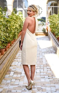 Venturing out: Lydia Bright, 25, bared her slender back in a cream halter neck dress and g...