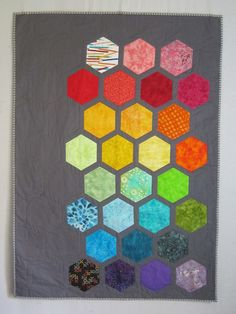 Big Bold Baby Hexagons Quilt from Quilts by Elena Modern gray background with bright appliqued hexagons Wall Hanging Ready to Ship. $90.00, via Etsy.