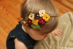 cool for kids and adults alike! and looks simple to make with a little felt, a headband, some bead embellishments and needle and thread!