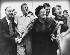 Family members react as former prisoner-of-war Crawford Love arrives home at Atlanta's Municipal Airport in 1953.