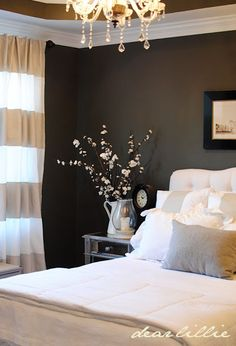 Love the dark color with light linens and stripes