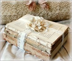 Antique books simply tied with ribbon and lace.