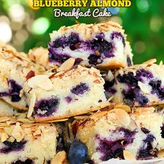 Blueberry Almond Breakfast Cake Recipe Desserts, Breakfast and Brunch with granulated sugar, large eggs, salted butter, almond extract, pure vanilla extract, all-purpose flour, fresh blueberries, sliced almonds