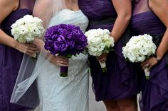 White Bridesmaids bouquets, Purple Bridal Bouquet. Wedding Flowers by Lexington Floral in Shoreview, MN.