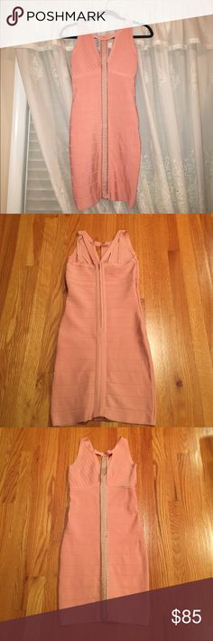 Bebe pink bandage dress Bebe pink bodycon dress with studded detail down the middle. Back zipper. Medium. Stretchy. Worn once. Perfect for a special occasion! bebe Dresses