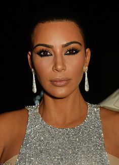 Laden: Kim's love of cosmetics was blatantly apparent as she went for heavy contouring pai...
