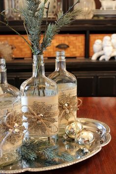 So pretty - empty glass bottle wrapped with sheet music - add snowflake and bells decoration - insert pine sprig - great accent or center piece.
