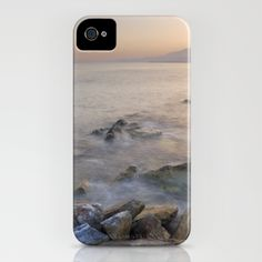 Sunset at the Mediterranean sea iPhone Case by Guido Montañés - $35.00