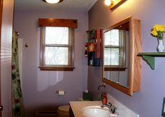 Full bath with fiberglass tub insert and huge linen closet that's deep enough to hold your comforters