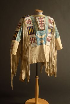 Native American Plains Indian Shirt, c.1880  Lakota (Souix)  Buckskin or elk hide, loom woven beadwork