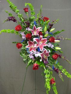 Standing funeral spray. #funeralflowers #stargazers