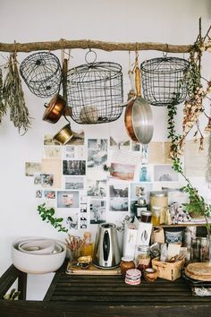 A lived-in kitchen with a DIY driftwood pot rack/herb drying rack