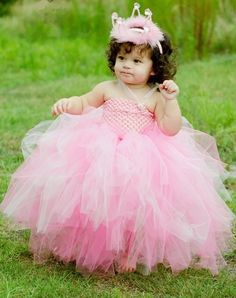 approx.$50.00 CAN  This is a must have for any princess or flower girl.  Floor length full tulle pink dress, with stretchy crochet band top.
