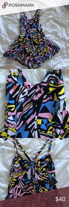 Nasty Gal Colorful Abstract Romper NWT.  Before leaving a comment: 🌹No trades 🌹Use the offer button and offers on bundles feature to discuss pricing 🌹Lowballs/rude comments get you blocked 🌹I only sell on posh 🌹I do not model 🌹I ship same day or next day 🌹If I don't respond, it's because your question was answered here! Nasty Gal Dresses
