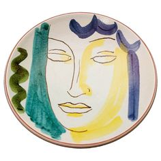 Art Deco Bowl with Face by Wilhelm Kåge for Gustavsberg  Sweden  Circa 1940s  The legendary Wilhelm Kåge, best known for his Argenta line of porcelain pieces for the Gustavsberg Studio, created this rare bowl in the 1940s. Reminiscent of the work of Picasso and Matisse, and featuring the bold colors of the Fauves, this piece is a very special example of the artist's work.