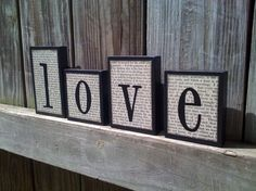 love blocks, matted with dictionary pages/newsprint