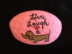 Cute little Dachshund painted rock by Phyllis Plassmeyer