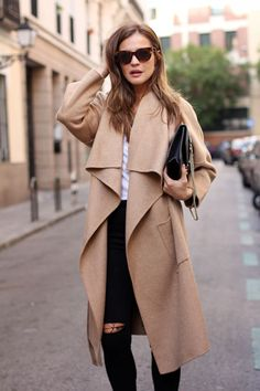 """Casual street style. An oversized camel coat is the perfect addition to your """"running around town"""" look."""