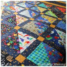 """An """"I Spy"""" quilt for a child -- made with bright, fun novelty prints that can encourage kids to hunt for different objects. Pattern from The Crafty Mummy."""