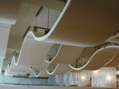 Pinta Acoustics. Acoustical ceiling wave cloud system with WhisperWave.