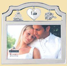 i do silver metal frame decorated with wedding charms holds a 4 x 6