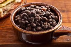 Add tomatillo salsa to a can of partially drained black beans. Yummy, and makes a great side!