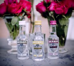 cute!!! Mini Smirnoff bottles party favors in Smirnoff Raspberry, Passionfruit and Coconut flavored vodkas