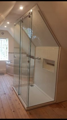 Frameless 3 sided sliding shower enclosure - installed to loft conversion with sloping ceiling. Frameless 3 sided sliding shower enclosure - installed to loft conversion with sloping ceiling. Attic Shower, Small Attic Bathroom, Attic Master Bedroom, Loft Bathroom, Upstairs Bathrooms, Bathroom Interior, Attic Renovation, Attic Remodel, Attic Spaces